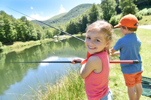 boy and girl fishing with fishing poles
