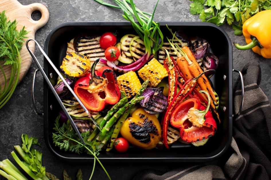 Freshly grilled vegetables in a grilling sheet pan, overhead view