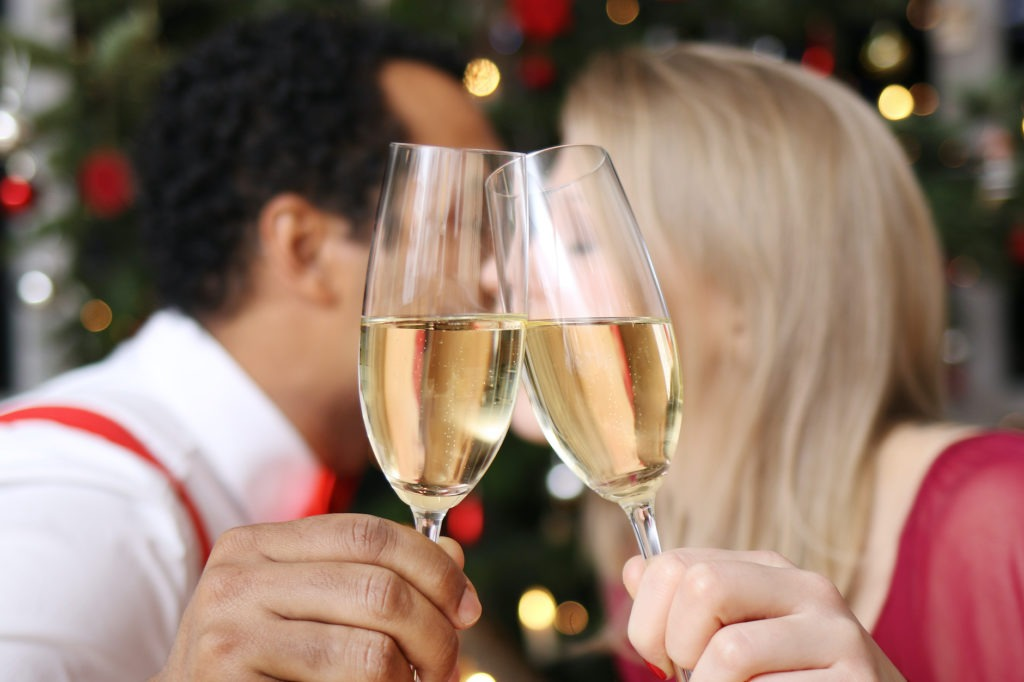 couple kissing at midnight on new year's eve