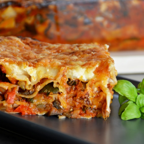 Zucchini lasagna on a plate with basil.