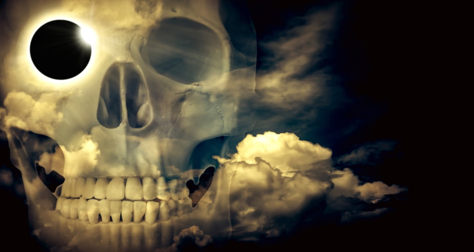 Closeup of a transparent skull with haunting skies in background.