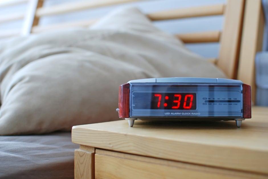 digital clock at bedside on nightstand
