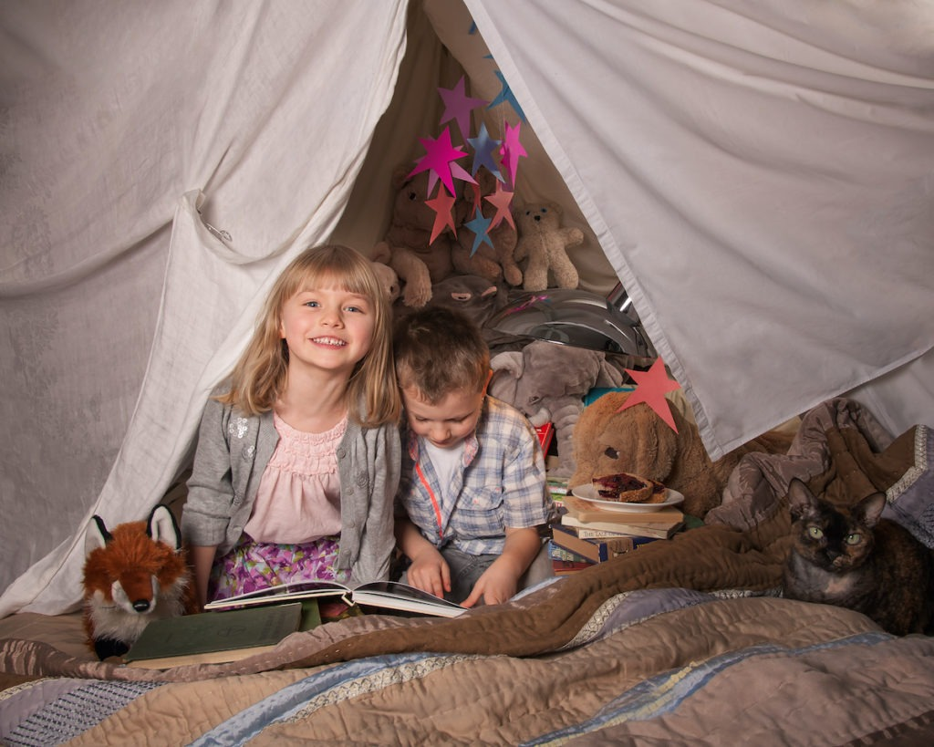girl and boy in a fort livingroom