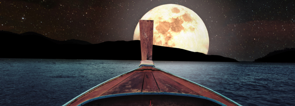 Front of rowboat with a bright full moon sitting on horizon in the distance.