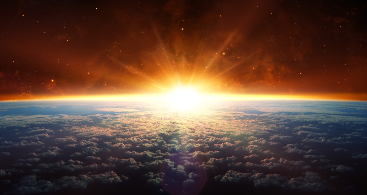 Sun rising over the sphere of the Earth.