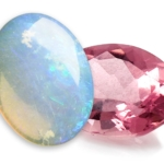 An opal pink and tourmaline birthstone symbolizing the month of October against a white background.