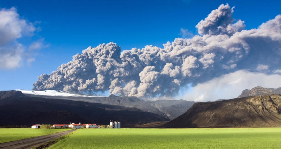 Eruption of the Eyjafjallajökull volcano with a large plume of ash clouds. Climate concept.