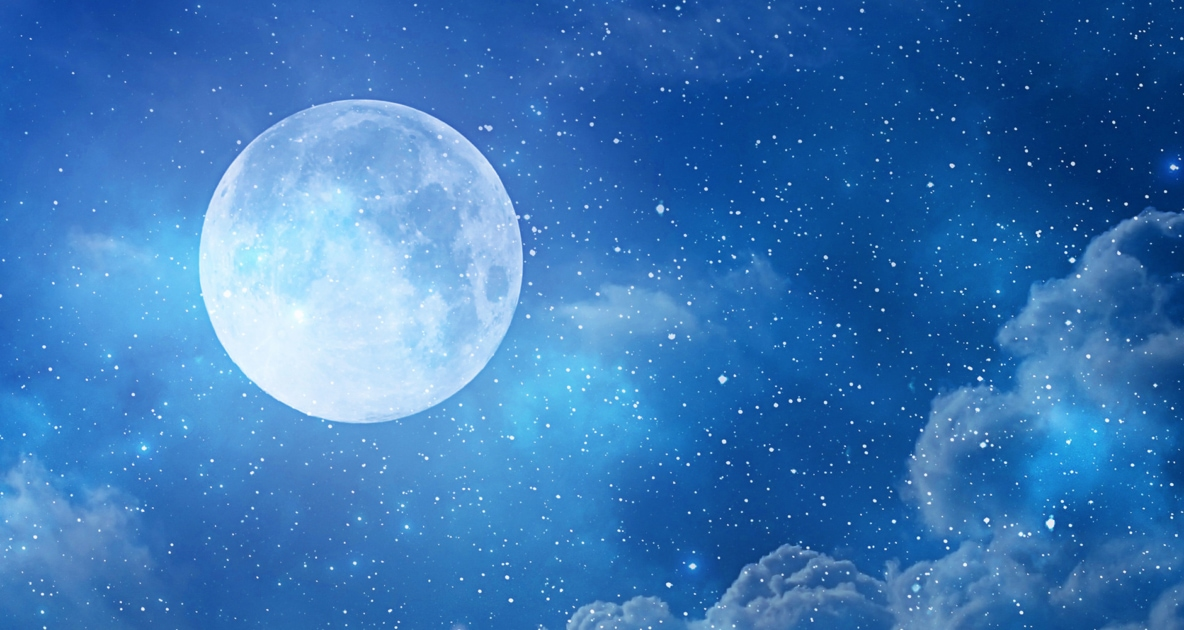 Blue Moon Appearing in a night sky with different shades of blue colors.