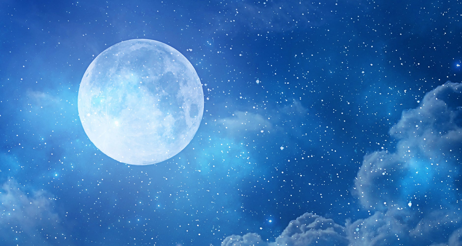 Blue Full Moon in Night Sky with Clouds