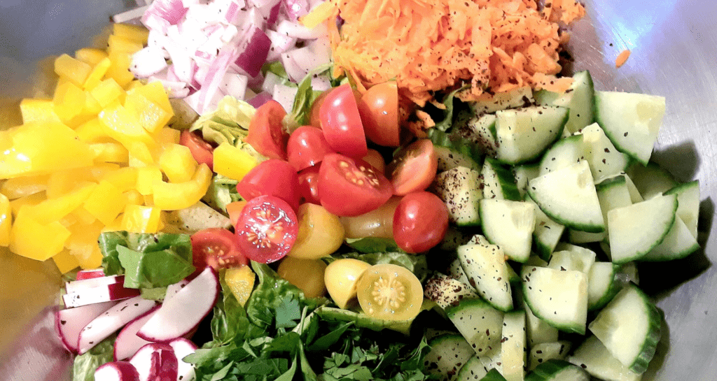 close up of chopped salad ingredients in a bowl