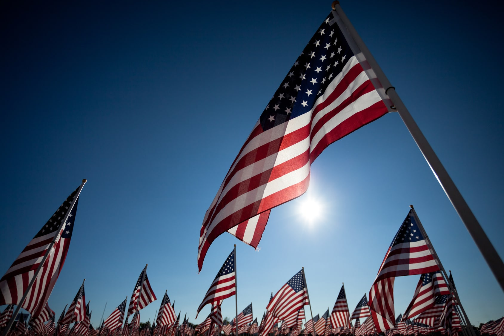 American flags with sun in background