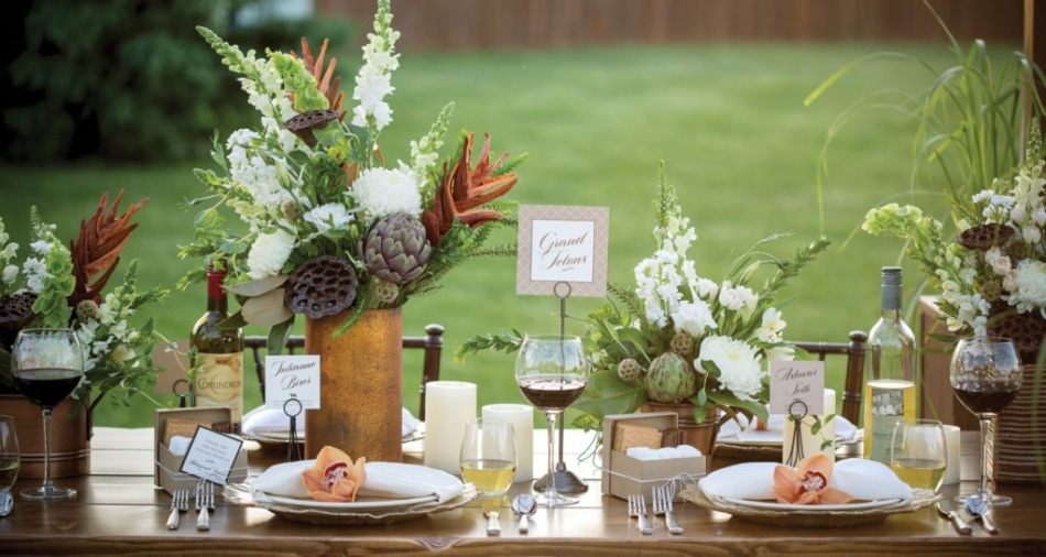 Wedding decorations and silverware on a table with a Grand Tetons card shown in the middle.