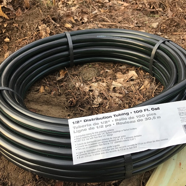 black irrigation tubing with label