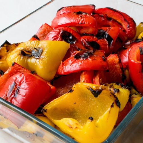 Grilled peppers in a glass dish.