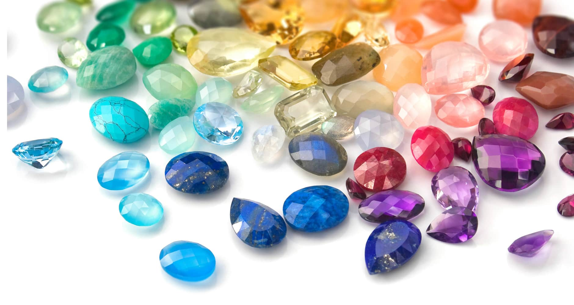Collection of gemstones on white table