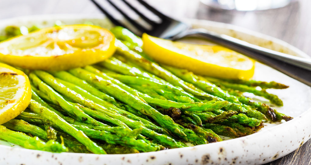 asparagus in a dish with lemon slices