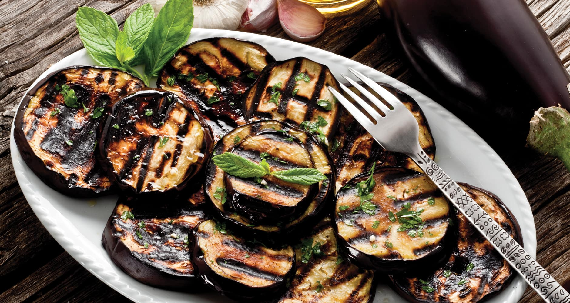 grilled eggplant slices on a plate.