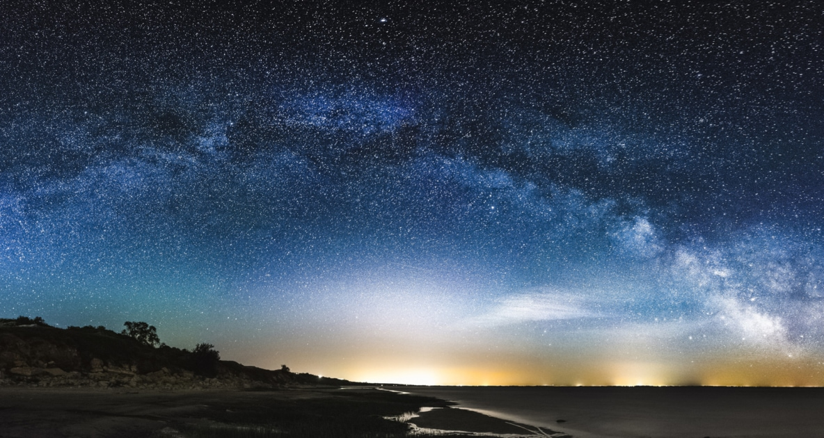 Milky Way Galaxy begins to appear over a setting sun.