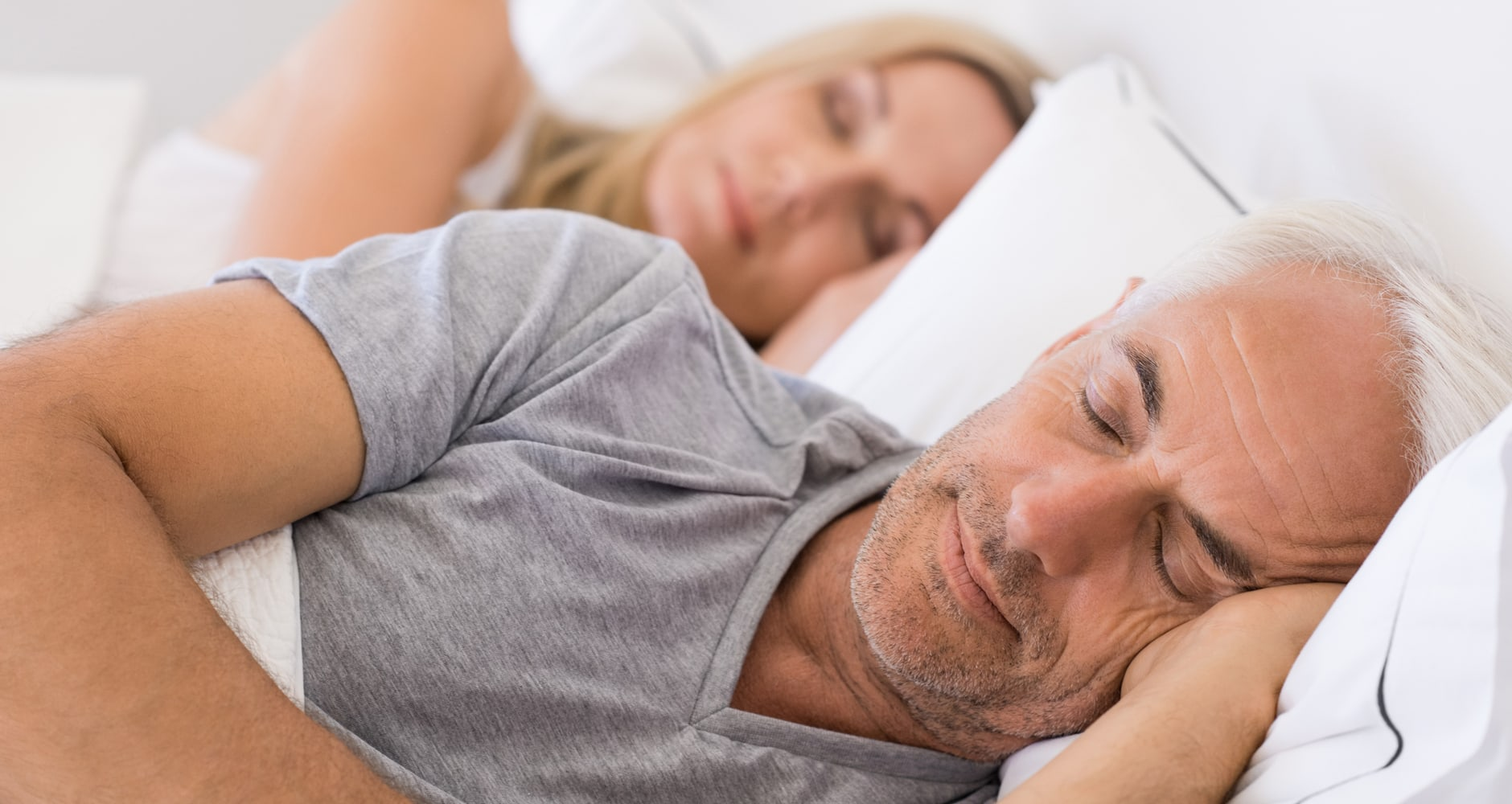 natural solutions for sleep - headshots of man & woman sleeping in bed