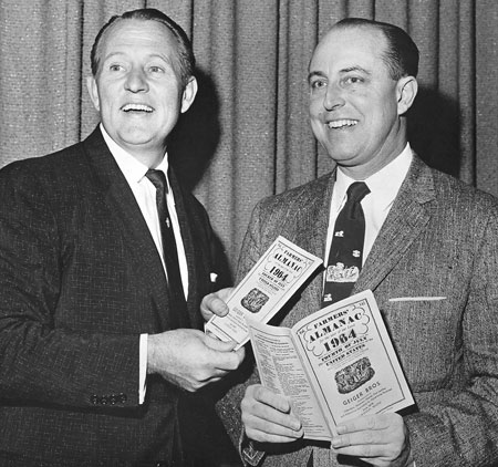 Ark Linkletter holding copies of the Farmers' Almanac with Ray Geiger.