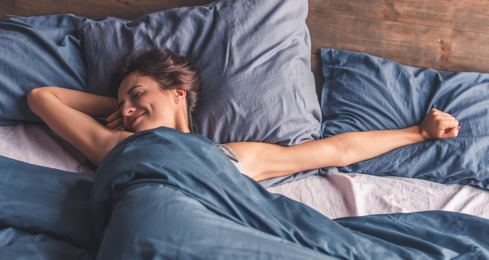 mom sleeping in bed getting some alone time for Mother's Day