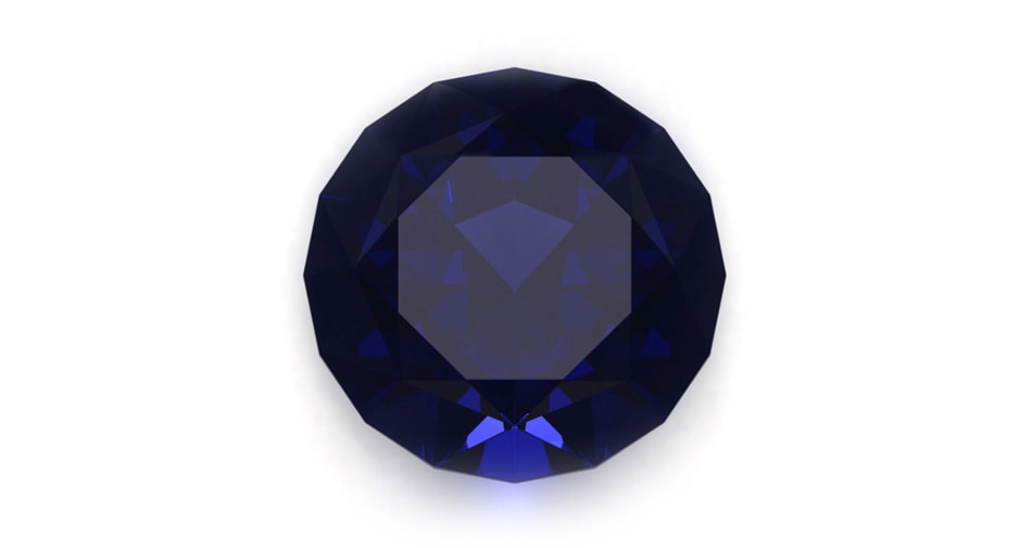 A sapphire birthstone symbolizing the month of September against a white background.