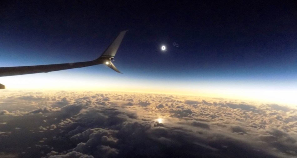Solar eclipse of August 21, 2017 as seen from airplane window. - Earth