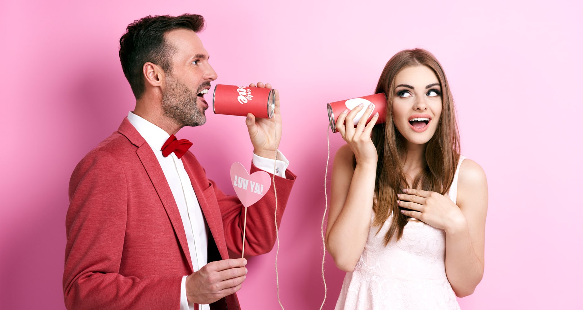 Valentine's Day quiz - man talking into a tin can linked by string to a woman listening through a tin can at the other end