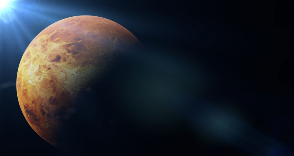 Illustration of Venus with Sun shining on part of planet.