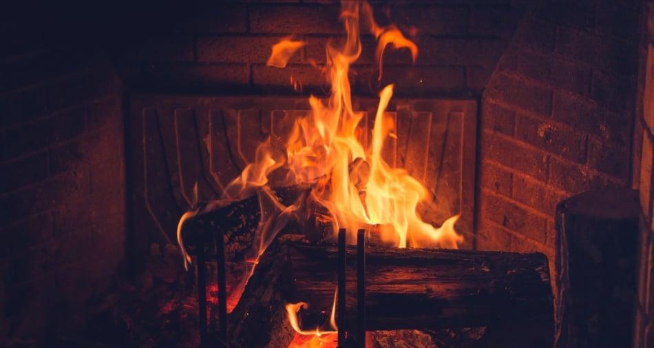 Yule logs burning in a fireplace.