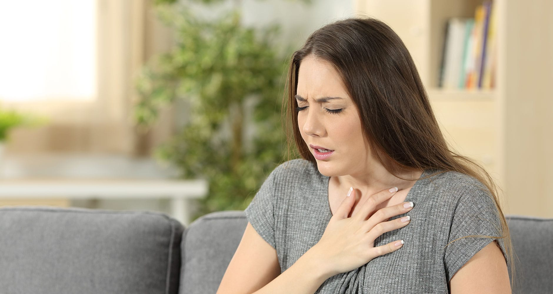 woman with asthma having difficulty breathing.