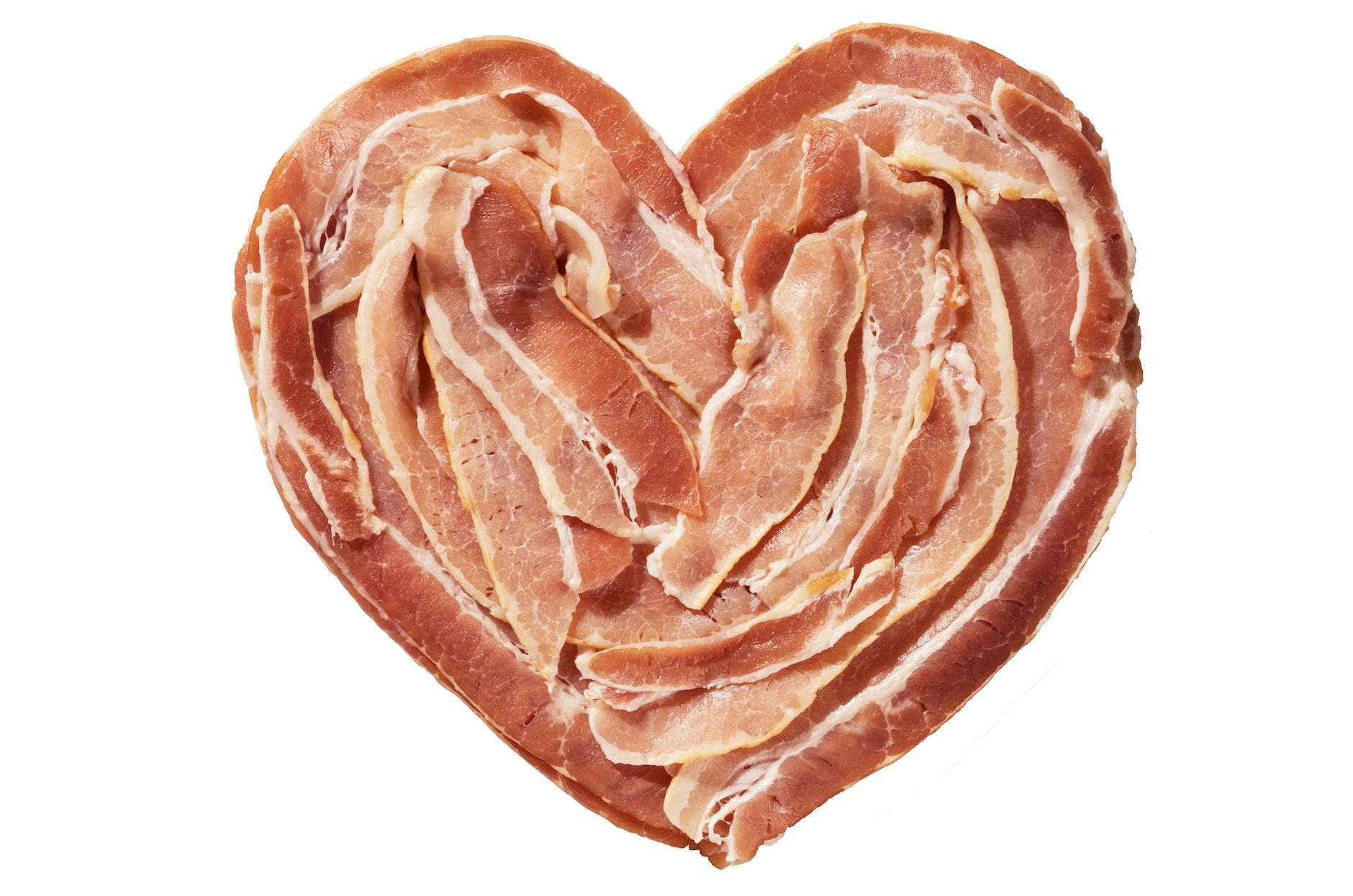raw bacon heart isolated on a white background