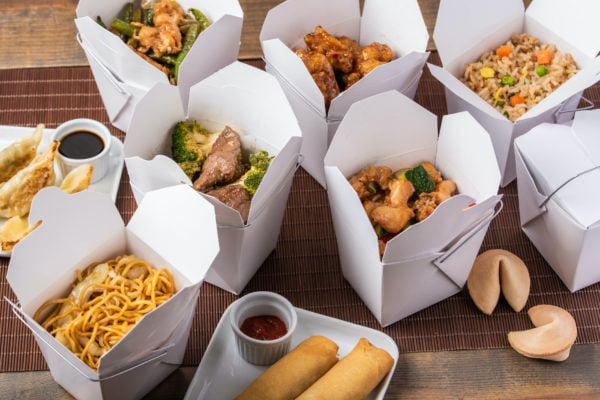 chinese food take out boxes filled with Chinese food.