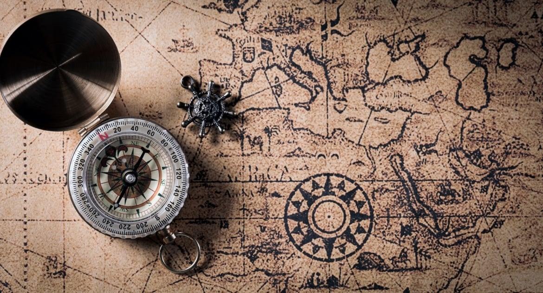 Vintage compass and retro treasure manuscript.