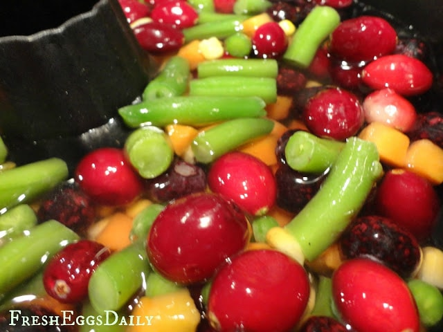 frozen vegetables and fruits in a bundt pan ready for freezing
