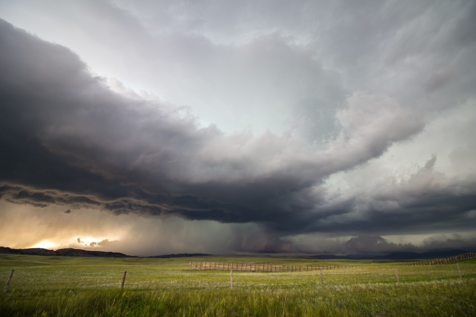 A supercell storm drops large amounts of rain and hail over the high plains of Wyoming in the evening.
