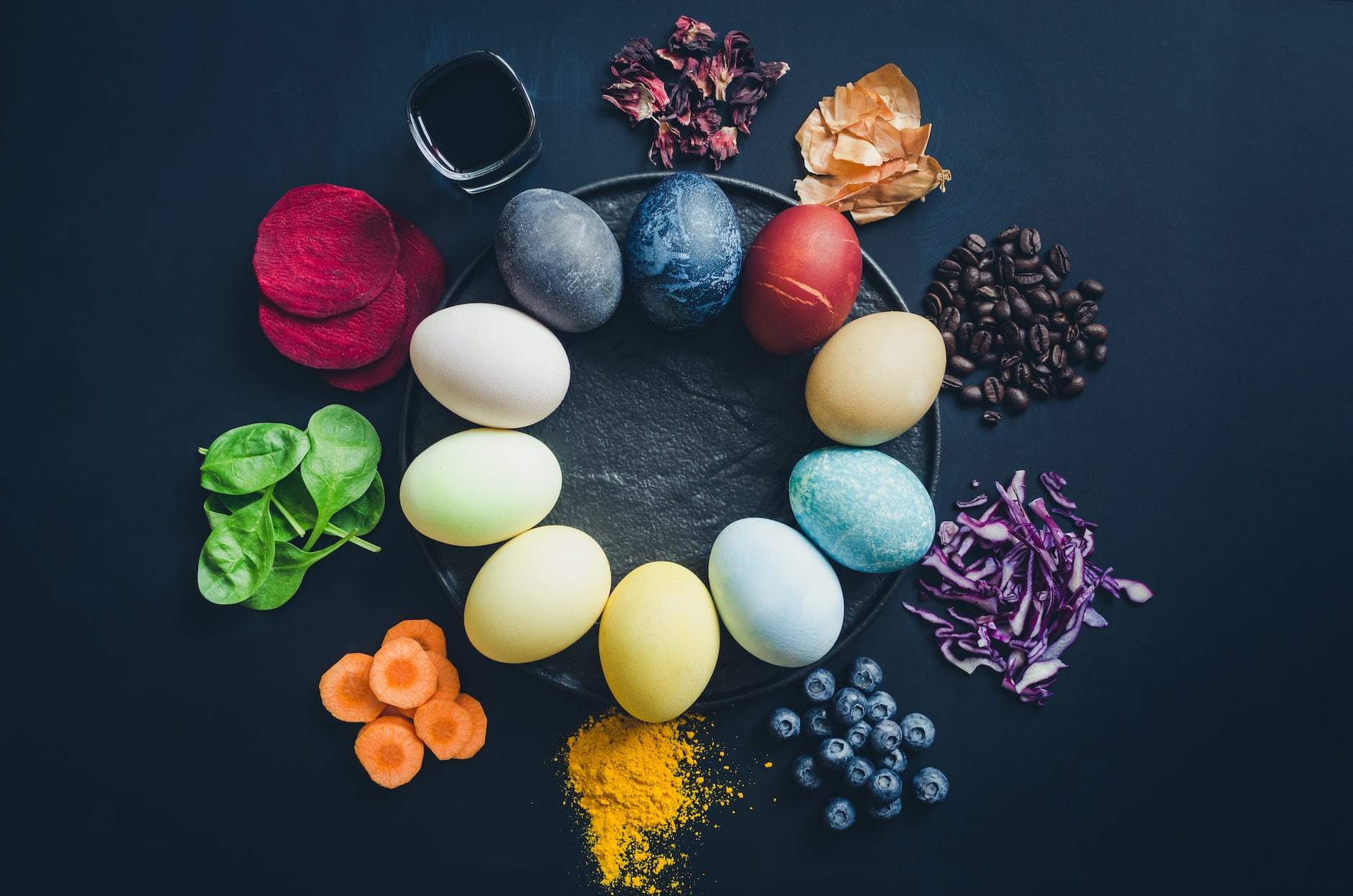 Easter eggs painted with natural egg dye from fruits and vegetables. Homemade naturally dyed Easter eggs with ingredients.