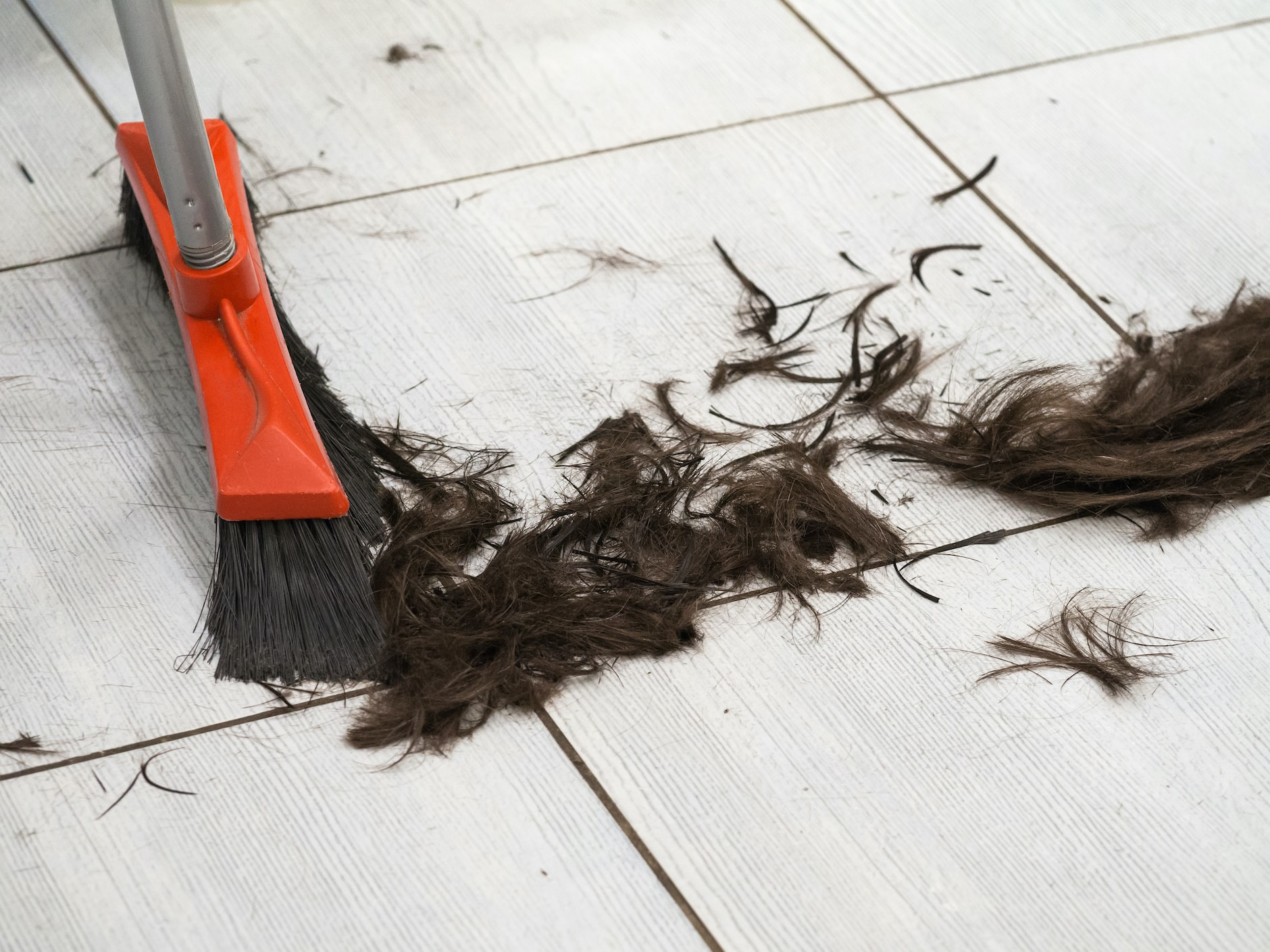 hair clippings being swept up at the barber