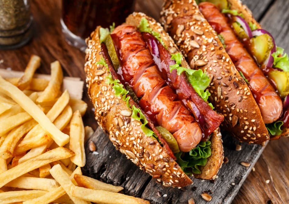 Barbecue grilled hot dog with french fries.