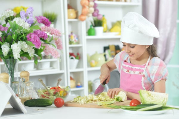 Girl cooking for her mother on mother's day