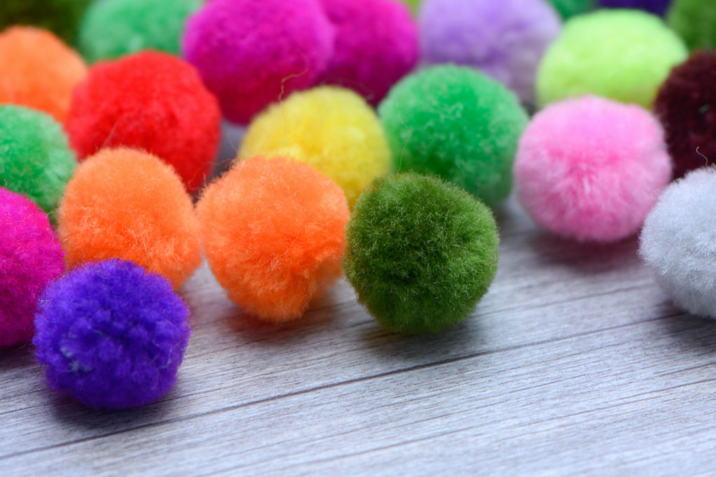 A colorful Pom Pom with white background