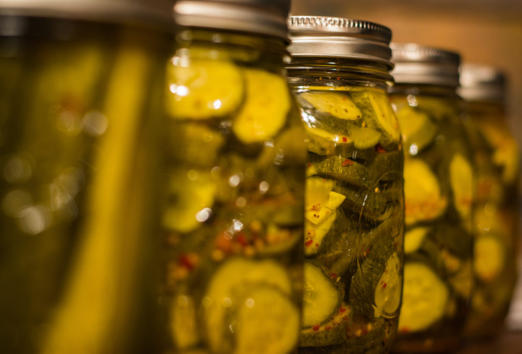 sliced cucumbers in jars - canning