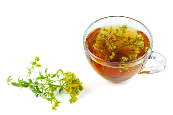 St. John's wort and herbal tea isolated on white background