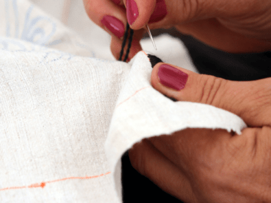 embroidering a holiday tablecloth