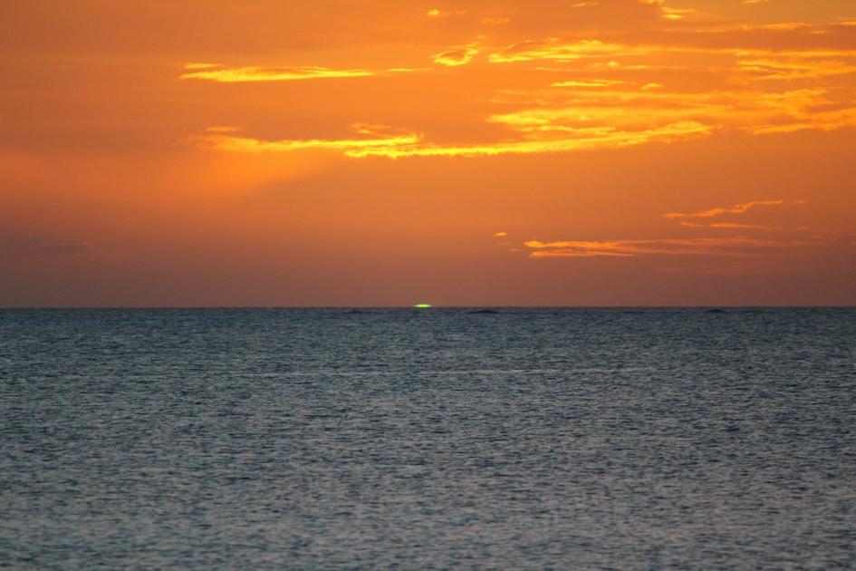 green flash at sunset along the ocean
