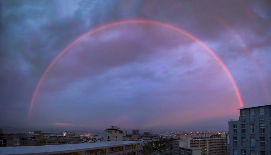 Monochrome red rainbow at sunset.