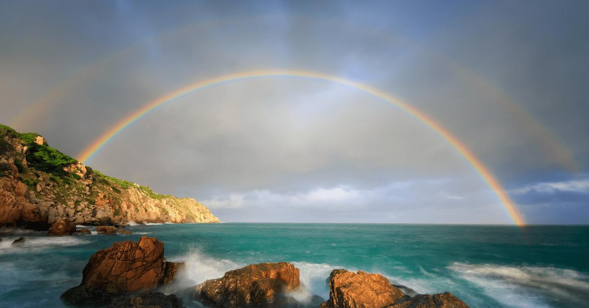 rainbow against the ocean
