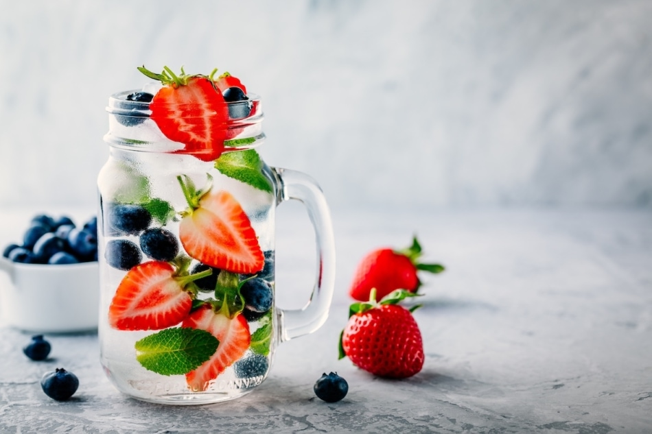 Strawberry tops infused water with berries and mint
