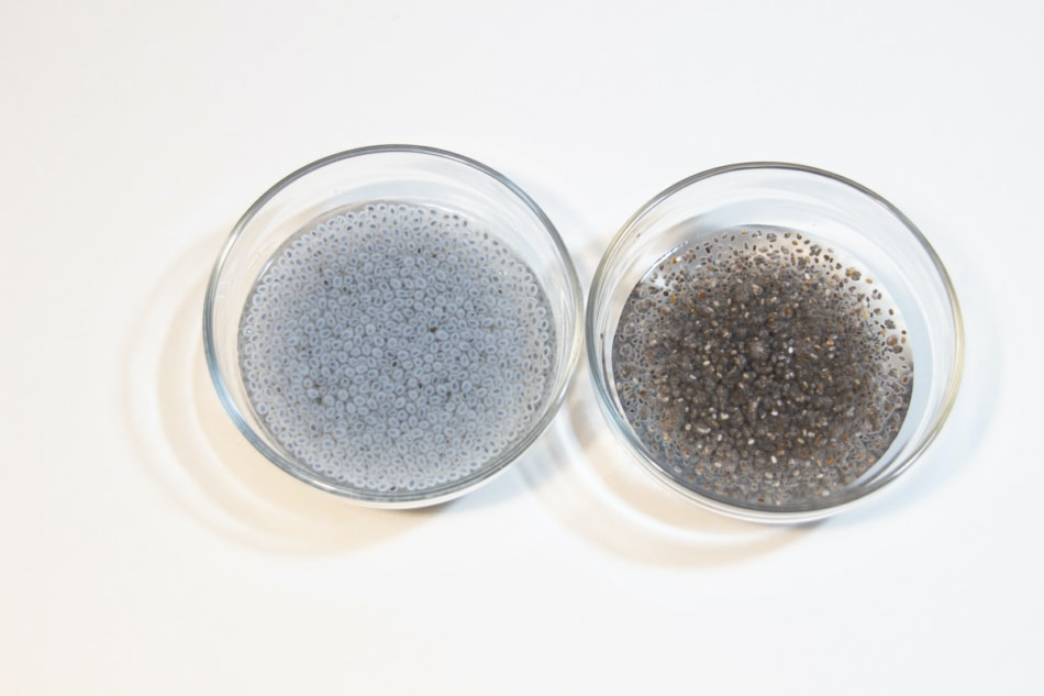 Side by side of basil seeds and chia seeds in a dish.