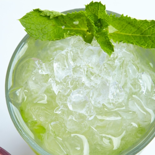Green summer drink with ice and mint.